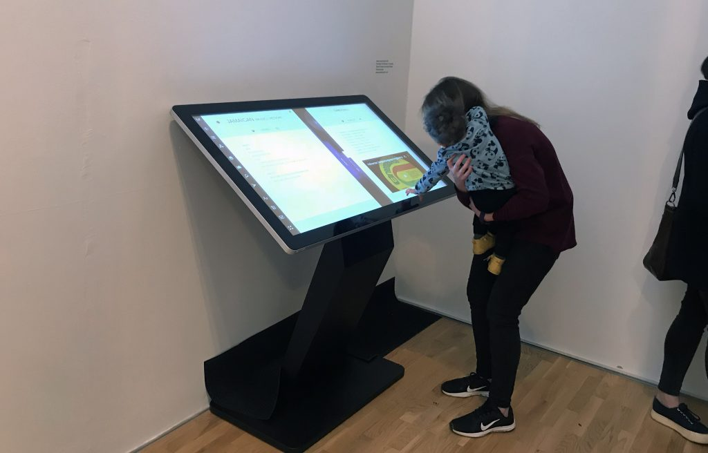 Exhibition visitors using a PCAP Touch Screen Kiosk
