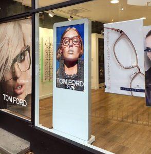 White Freestanding Digital Posters in shop window display