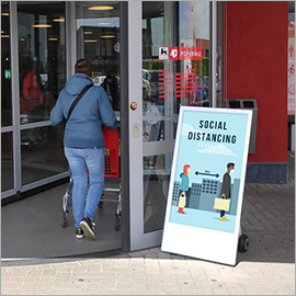 Outdoor Battery A-Board used as a COVID-19 solution outside a retail supermarket store